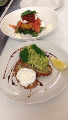 Smashed avo with goats cheese & poached egg on quinoa & rye loaf   Delicate potato croquettes on sautéed spinach with smoked salmon, poached egg & beetroot jam