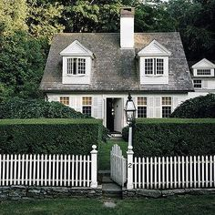 A traditional Cape Cod Cottage giving major curb appeal inspiration.