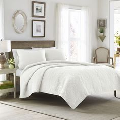 Give your bedroom a vintage style look with this exquisite quilt set, crafted of 100-percent cotton. Hand tied closures on the shams add decorative detail. This lovely set is in white is sure to accen