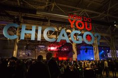 """IPW Opening-Night Party The opening-night party took place at the 90,000-square-foot Cinespace film studio on Chicago's West Side. When guests entered, they were greeted with giant blue-and-red letters that spelled out: """"How Do You Chicago?"""" Photo: Timothy Musho Photography"""