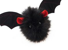 Hi, my name is Vlad and I am a Fuzziggle. My fur is black, my ears are red and I'm super fluffy. I'm a small size bat; my body is about 4x4x5 inches, but my wingspan is 12 inches. I'm made of plush fa