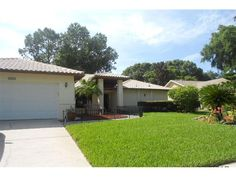 Great looking single Family Ranch style home with 3 BR, 2 Bath, 2 car garage and a 30' x 15' swimming pool under birdcage. This home is layout on a quiet lane in a lovely deed restricted �Lake Valencia� subdivision in the heart of Palm Harbor.
