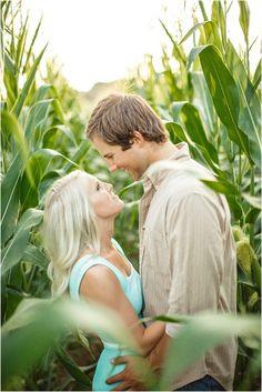 Farm engagement photos in a corn field.