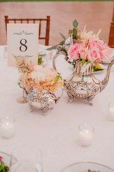 Love the silver used as vases for a wedding shower idea
