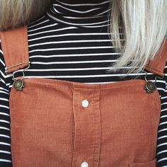 Brown and Black - black and white striped turtle neck paired with a pair of brown button up overalls
