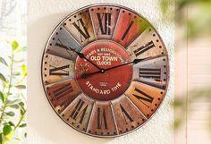 Die Uhr im Retro Look wurde aus Holz gefertigt und hat die Maße (B/H/T): ca. 58/58/5 cm.  Artikeldetails:  Stylische Wanduhr im Retro-Look, Mit bunten Ziffernfeldern, Maße (B/H/T): ca. 58/58/5 cm,  Material/Qualität:  Holz,  ...