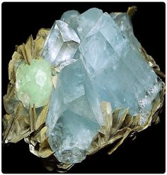 Doubly-terminated aquamarine crystals in cluster with light green Fluorite, atop silvery-tan Muscovite blades--how beautifully these minerals coexist!