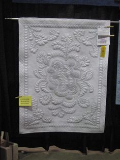 Carrie Zizza's quilt - Ribbon Winner Vermont Quilt Festival. My first attempt at: Wholecloth, Original Design and Trapunto. You can't see them, but the crystals hide all the places I accidentally sliced through the top layer.