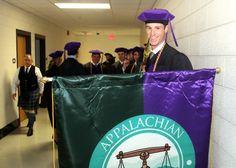 SBA President with school banner