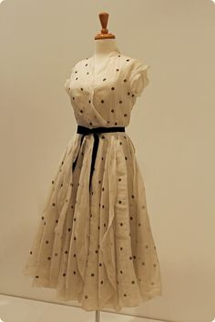 """""""Silk with painted polka dots dress,Barbara Coty (Graduation) 1951Australia -By the early 1950s Christian Dior's 'New Look'had taken the world by storm, and the little countrytown of Canowindra in New South Wales was noexception… After joining the weekly sewing circleat the church hall, Barbara Coty proved to be sogifted that she won a scholarship to East SydneyTechnology College. Barbara hand-painted polkadots on this gloriously frothy silk confection shemade to wear to her…"""