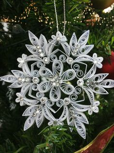 Christmas tree ornament. Quilled snowflake.