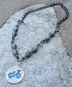 The colors of the stones on this necklace are the perfect shade to match the bicycle in the pendant. And that chain in the back reminds me of a bike chain! Designed by Cynthia Riggs http://cynthsblog.blogspot.com/2012/07/simple-truths-celebration-blog-hop.html?showComment=1342194046564#c5606045440507770554