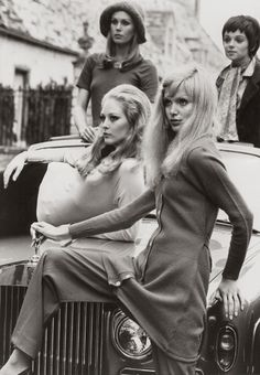 Madeline Smith, with Katia Christine (on the hood), Joanna Lumley (background left) and Linda Morand (background right) [1969]