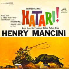 """Motion picture soundtrack, """"Hatari!"""" record album.  Music composed and conducted by Henry Mancini, including """"Baby Elephant Walk."""" The back cover states: """"In wildest Africa with 1962's double 'Oscar' winner Mancini.""""  The motion picture starred John Wayne. This album was released in 1962 by RCA Victor Records."""