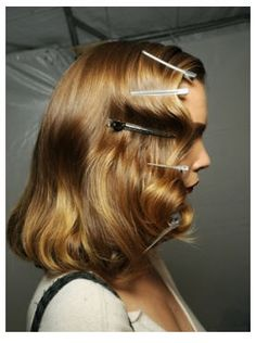 how to create a 1940's hairstyle, gonna have to get some of those clips and try.