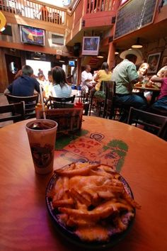 An order of loaded #cheese fries is a must at #EskimoJoe's in Stillwater, #Oklahoma.