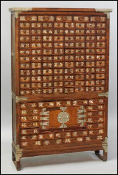 "KOREAN APOTHECARY CABINET. H: 65"" W: 39"" D: 11.5"""