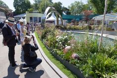 Fans stop to get a quick snap of our finished garden on press day.