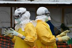 Medical personnel at a Medecins Sans Frontieres faciility in Monrovia, Liberia, wear protective gear to guard against the Ebola virus, September 7, 2014.