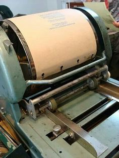 This is a Memiograph Machine. It was used to make copies.  It made the paper wet, smell funny & the ink was a purple color.