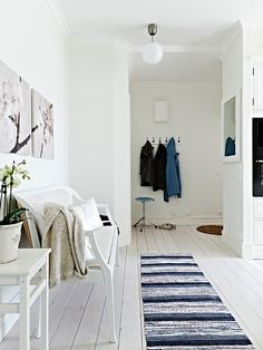 Floors painted white. http://www.cuded.com/2012/06/lovely-planned-apartment/