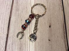 https://www.etsy.com/uk/listing/578971864/bead-emoji-and-horse-shoe-charm-keyring?ref=shop_home_active_1