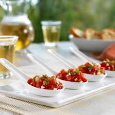 Tomato-Parmesan 'Spoonfuls'  Tomatoes flavored with olive oil, balsamic vinegar and soy sauce for a quick and easy hors d'oeuvre that can ...