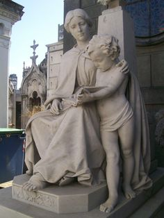 Statues in the cemetery of Recoleta, Buenos Aires. Honoring to a teacher.