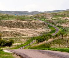Highway 2, Nebraska. Sandhills (grass-covered sand dunes) make up nearly one-fourth of Nebraska, undulating in slow hypnotic curves as far as the eye can see.