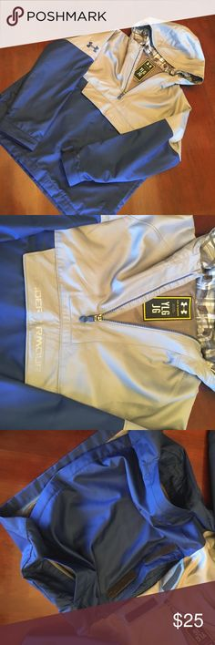 NWOT youth L Under Armour Storm pullover NWOT youth L Under Armour Storm pullover. Navy and grey. Front and side pockets lined in soft fabric. Hoodie style. Windbreaker and waterproof. Under Armour Jackets & Coats