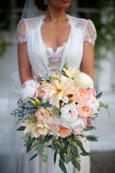 Stunning Wedding Bouquet Which Includes: White Peonies, Pastel Yellow Dahlias, Pink Lisianthus, Pink Garden Roses, Peach English Garden Roses, Lace Leaf Dusty Miller & Green Seeded Eucalyptus