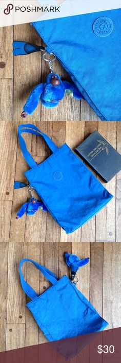 """Vintage Kipling celule blue small tote w/monkey EUC. Small tote perfect for a lunch or as a small handbag. Approximate dimensions are: 8.5x10.5x3"""". Three pockets inside, one of which is zippered.  Comes w/ a blue monkey named Kyle. Kipling Bags Totes"""