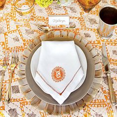 Sunny Summer Table Setting | Ground an outdoor setting with layers of natural materials, such as these wood chargers and hand-thrown plates. | SouthernLiving.com