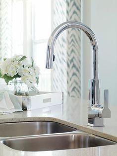 Modern design with a Moen kitchen sink. Seen in The Hampton Avenue, an Orlando community.