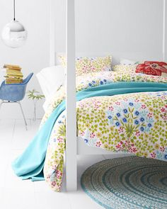 A fresh, vibrant print adapted from hand-painted artwork brings a colorful flower motif to life on our cotton percale sheets. Complete the room with our round Fair Isle Hooked Wool Rug and hooked wool pillow cover.