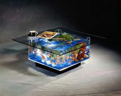 """Fish Tank Coffee Table. """"This fish tank coffee table is a crowd pleasure. Its base is a fully functional aquarium, and due to the beleveled glass, nothing you place on the table will disturb the fish. There is a two inch opening on the surface where feeding occurs and the entire glass top is easily lifted when it is time to add fish or redecorate."""" Table Aquarium, Aquarium Terrarium, Home Aquarium, Aquarium Fish Tank, Aquarium Stand, Tropical Aquarium, Tropical Fish, Fish Aquariums, Marine Aquarium"""