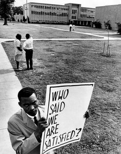 """Who said we are satisfied?"" - High School picketer Unidentified photographer, 1965 — in Houston, TX."