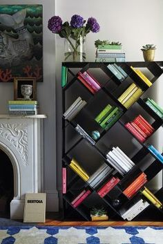 Group Similar Book Colors Together // Anthropologie Tip-Turned Bookshelf #AnthroFave