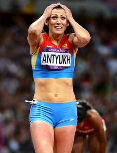Russia's Natalya Antyukh lets it sink in after winning the gold medal in the 400-meter hurdles.