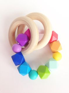 Hexagon Teething Ring, Baby Teether Toy, Wooden Teether, Rainbow Silicone Teether, Silicone Beads Teething Ring, Wooden Teether, Chew Beads by TheTeethingFairy on Etsy https://www.etsy.com/listing/291050739/hexagon-teething-ring-baby-teether-toy