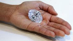 A New York auction house is showing off what it calls the world's greatest white diamond on the block -- a 118-carat stone from Africa the size of a small egg. The oval diamond glistened in its glass case Wednesday at Sotheby's Manhattan headquarters, not yet mounted after it was mined and cut two years ago. It will be auctioned in Hong Kong on Oct. 7 and has a pre-sale estimate of $28 million to $35 million.