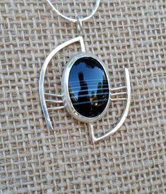 Black Lace Agate - somewhat abstract with a geometric flair, find it on Etsy listing at https://www.etsy.com/listing/204760109/sterling-silver-pendant-geometric-design