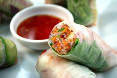 Shrimp Summer Rolls. Rice paper is filled with thin bean thread noodles, a variety of vegetables, and succulent shrimp.  Serve these delicious summer rolls with sweet chili sauce. - Foodista.com