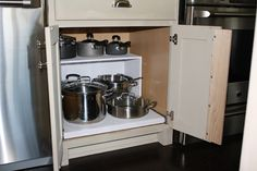 DIY Queen.  http://brightoncottage.blogspot.com/2012/09/making-kitchen-cabinet-more-functional.html#more