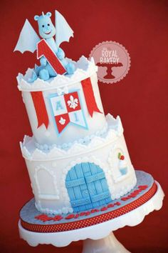 Castle Cake - This would be perfect for my son's indoor castle moon bounce party. I should darken the blue and add vibrant yellow and red colors to coordinate with the invites and the castle moon bounce.