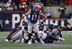 Julian Edelman Photos Photos - Julian Edelman #11 of the New England Patriots runs the ball in the second half against the Houston Texans during the AFC Divisional Playoff Game at Gillette Stadium on January 14, 2017 in Foxboro, Massachusetts. - Divisional Round - Houston Texans v New England Patriots