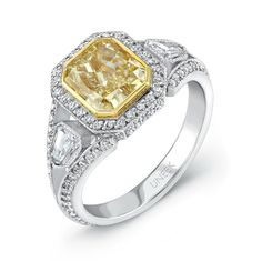Uneek Natureal Yellow Radiant Diamond Engagement Ring LVS387 - Fancy yellow radiant diamond center bezel set in a split shank platinum pave set diamond ring.