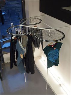 VM | Visual Merchandising | Retail Display | Retail Fashion Display | VM Fashion | Retail Design | Bike Wheels as Apparel Lazy Susan