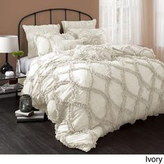 I love this. I like the white version best. (This one is ivory.) Riviera 3-Piece Comforter Set.