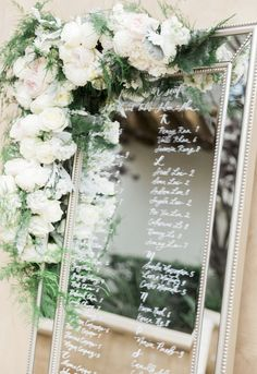 Place card, escort card mirror with calligraphy and flowers. Wedding at Serra Plaza. Florals by Jenny// Devon Donnahoo Photo//Pure Lavish Events